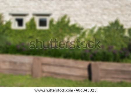 Defocused and blurred image for background of vintage wall house - stock photo