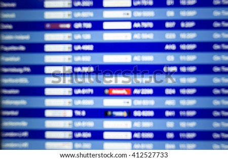 Defocused background. Board listing arrivals and departures. Airport schedule. Vacation flight schedule  - stock photo