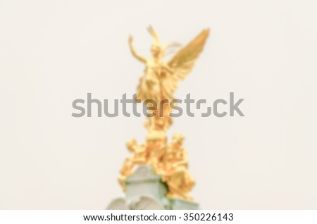 Defocused background of Golden Statue at Buckingham Palace, London. Intentionally blurred post production for bokeh effect - stock photo
