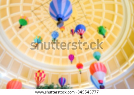 Defocused background of Hot Air Ballons inside a Dome. Intentionally blurred post production for bokeh effect - stock photo