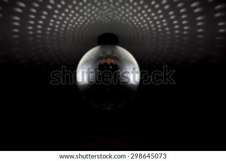 Defocused Background of Silver disco mirror ball - stock photo