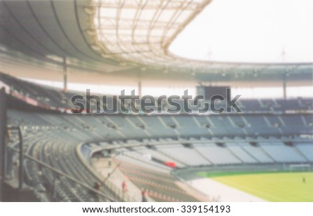 Defocused background of the Stade de France in Saint Denis, Paris. Intentionally blurred post production for bokeh effect - stock photo