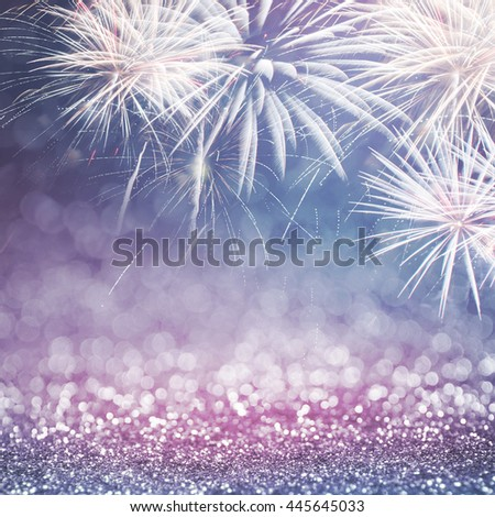 Defocused blue and pink fireworks and bokeh at New Year and copy space. Abstract background holiday. - stock photo