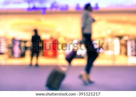 Defocused blur female passenger walking in terminal  airport - Traveling and airport shopping concept - Soft marsala filter- Defocused image -  - stock photo