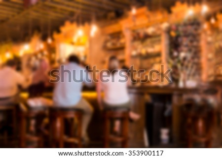 Defocused blur of bar at pub with people - stock photo