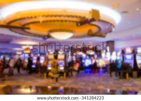 Defocused blur of casino slot machine area - stock photo