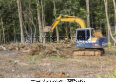 Defocused blur of crawler dozer working in the construction site for background - stock photo