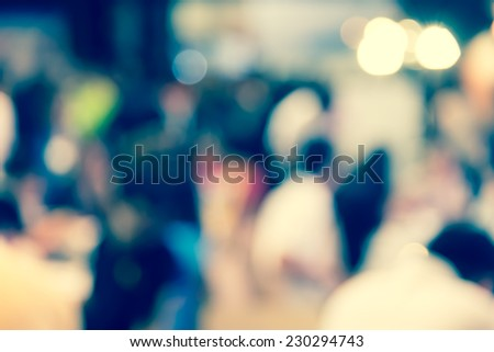 Defocused blur of unrecognized crowd people in urban background - stock photo