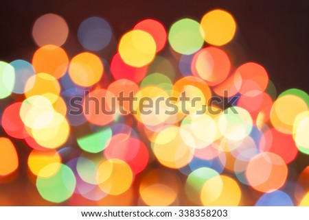 Defocused bokeh Christmas lights background - stock photo