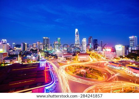 Defocused bokeh lights as abstract background of Impression, colorful, vibrant scene of traffic, dynamic, crowded city with trail on street, Quach Thi Trang roundabout at Ben Thanh market, Vietnam - stock photo