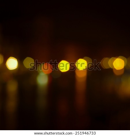 defocused bokeh lights on dark background - stock photo