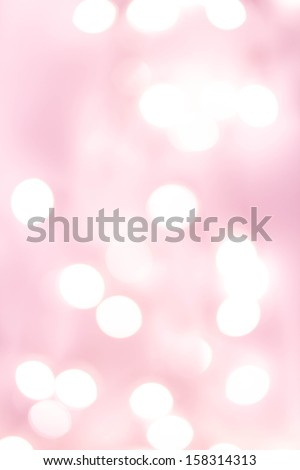 Defocused Bokeh twinkling lights background. Colorful   Abstract twinkled  bright golden festive background, soft pink and red colors.  - stock photo