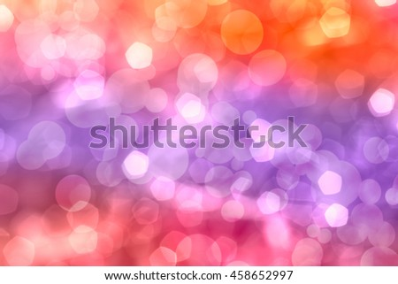 Defocused bokeh. Twinkling lights vivid background for Christmas and Happy new year holiday. Festive elegant abstract blurred background with colorful circular and pentagon bokeh with bright lights. - stock photo