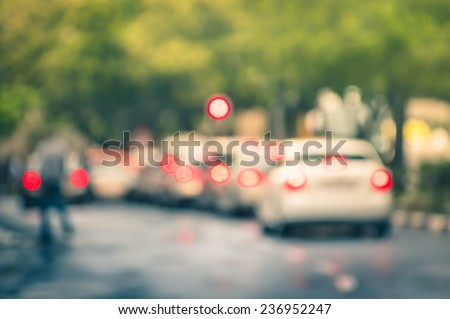 Defocused cars in city traffic jam in a rainy day - Johannesburg suburb streets with blurred bokeh - stock photo