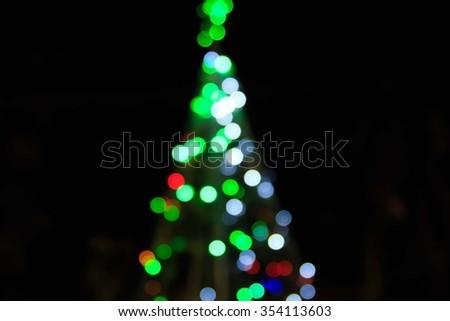 Defocused Christmas Bokeh background on chrismas day - stock photo