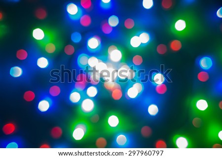 Defocused Christmas colourful lights on black. Multicoloured bright lights represented by red, green, blue, navy blue, brown etc. - stock photo