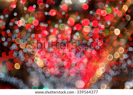 defocused christmas lights on bright colors - stock photo