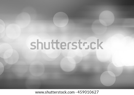 Defocused city night filtered bokeh on gray tone abstract background. - stock photo