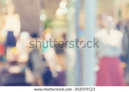 Defocused clothing store front entrance displaying woman's fashion - stock photo