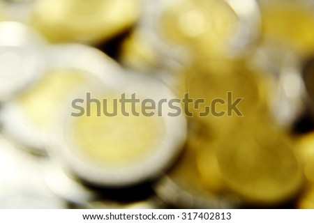 Defocused coins abstract background - stock photo