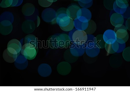 defocused colored lights on the black background - stock photo