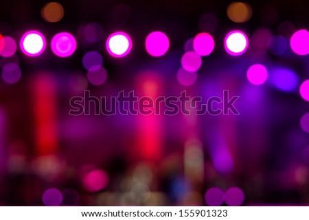 Defocused entertainment concert lighting on stage, bokeh. - stock photo