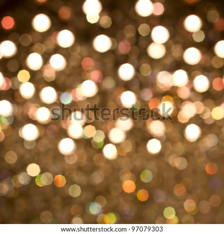 Defocused gold bokeh background with yellow, orange, green and white lights - stock photo