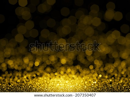 Defocused gold sparkle glitter lights background. Glitter bokeh background - stock photo