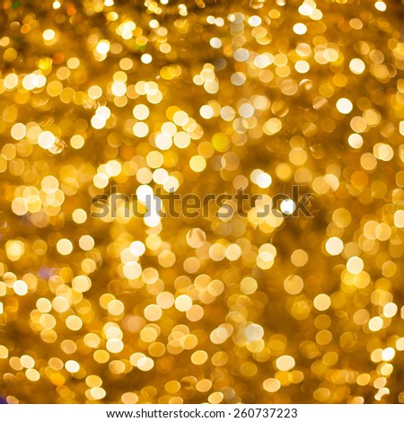 Defocused golden abstract christmas background of blurred lights with bokeh effect - stock photo