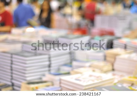 Defocused image of people at bookstore - stock photo