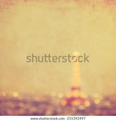 Defocused lights of night Paris in grunge and retro style. - stock photo