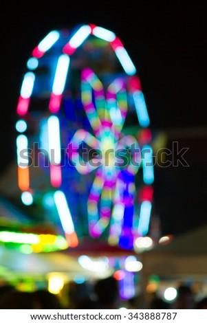 Defocused of ferris wheel in carnival. - stock photo