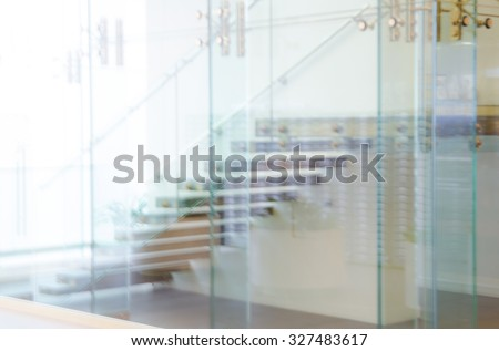 Defocused Office Building Lobby or hospital Background. Image staircase, glass walls and doors. Modern interior. - stock photo