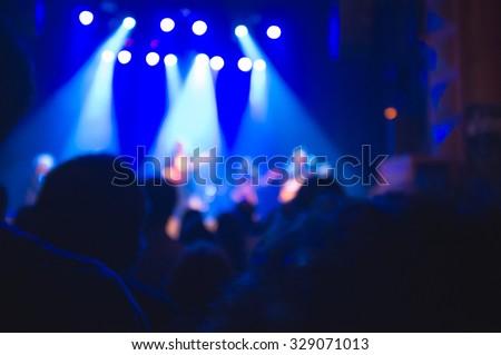 Defocused pop rock concert background. - stock photo