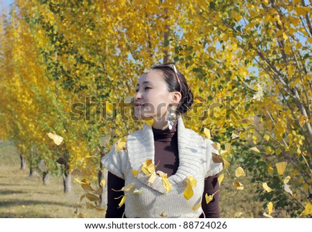defoliation and smile young woman - stock photo