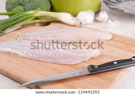 Defrosted fish fillets with vegetables horizontal - stock photo