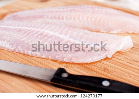 Defrosted raw fish fillets closeup - stock photo