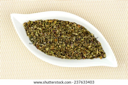 Dehydrated and dried basil leaves chopped in gourmet dish - stock photo