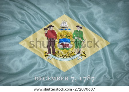 Delaware flag on fabric texture,retro vintage style - stock photo