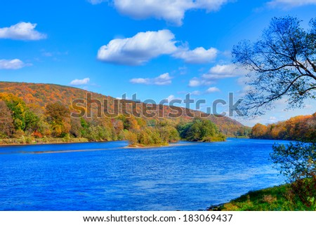 Delaware Water Gap in Autumn with colorful foliage with forest and mountain over river. - stock photo