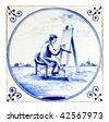 delft blue tile painter - stock photo