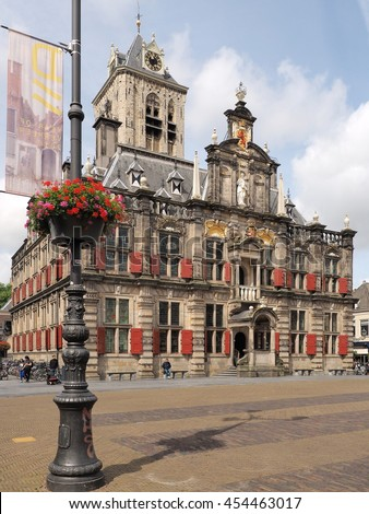 Delft, Netherlands - July 6, 2016:  The medieval town hall in the city of Delft at the main city square. - stock photo