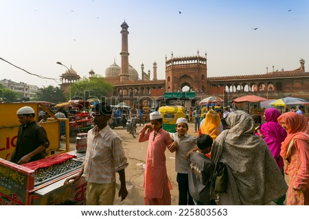 DELHI, INDIA - CIRCA MAY 2014: Overcrowded street in old town, and the Jama Masjid Mosque.The Jama Masjid is the principle mosque of Old Delhi. - stock photo