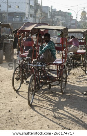 DELHI INDIA-DEC 10 : group of rickshaw driver waiting for passengers in chandni chowk.this area is in old delhi, that is famous place of Delhi on december, 10, 2014, india - stock photo