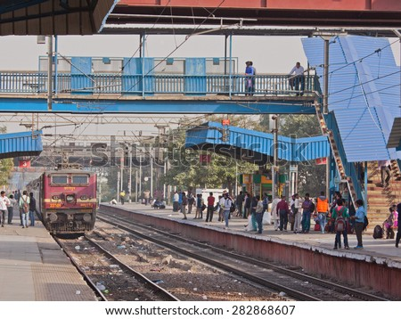 DELHI, INDIA - FEBRUARY 26, 2015: A passenger train approaching Shivaji Bridge station in the city en route for New Delhi. The Indian government is planning increased spending on the vast rail network - stock photo