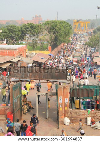 DELHI, INDIA - FEBRUARY 20, 2015: people walk on pedestrian street in Delhi between mosque and Red Fort - stock photo