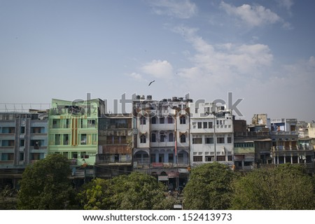 DELHI, INDIA - NOV 18: A classical street and old buildings in Old Delhi. November 18, 2012 in Delhi, India. The lifestyle in old delhi is still well kept like that in 100 years ago.  - stock photo