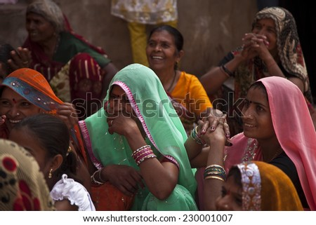 Delhi, India - 16 November, 2010: Traditional Indian women are in sari costume covered her head with veil, India - stock photo
