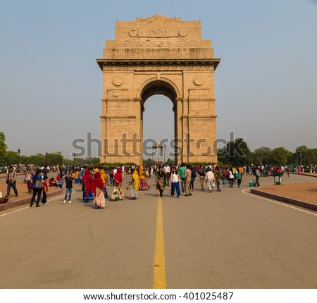 DELHI, INDIA - 19TH MARCH 2016: The outside of the India Gate War Memorial during the day. Large amounts of people can be seen outside and around it. - stock photo