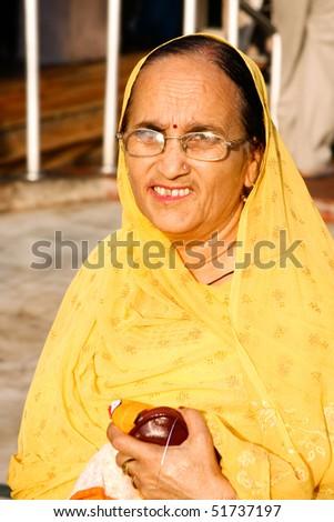 DELHI - SEPTEMBER 22:  Old Sikh devotee in traditional sari at Sis Ganj Gurdwara on September 22, 2007 in Delhi, India. Sikh temples are open to  men and women unlike some religions. - stock photo
